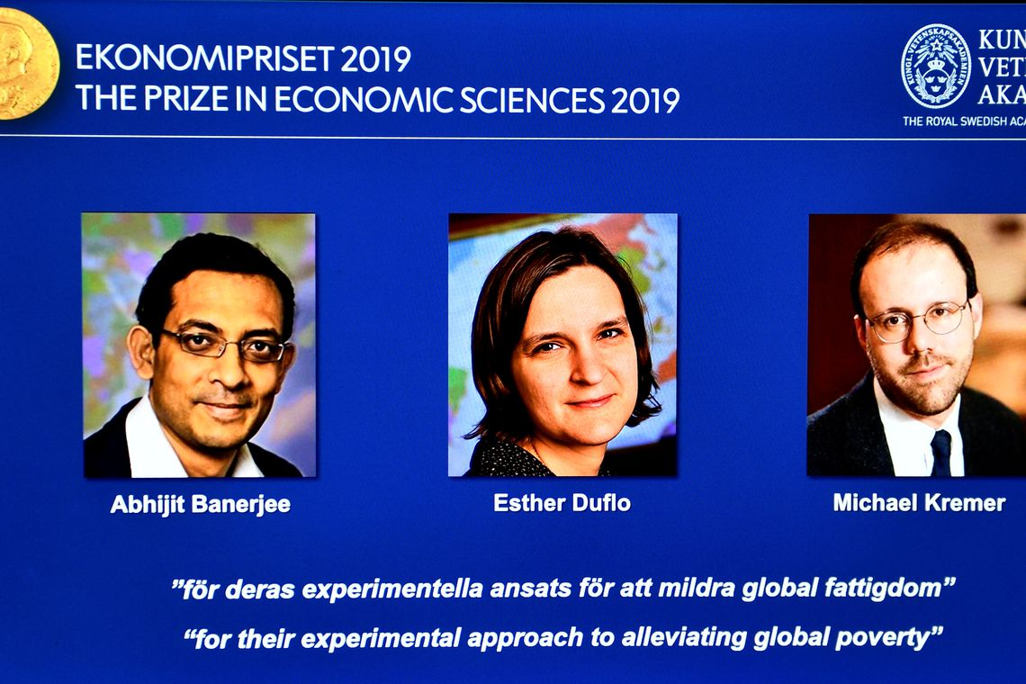 The portraits of Abhijit Banerjee, Esther Duflo, and Michael Kreme, who have been announced the Nobel Prize in Economic Sciences 2019 winners, are seen at a news conference at the Royal Swedish Academy of Sciences in Stockholm, Sweden, October
