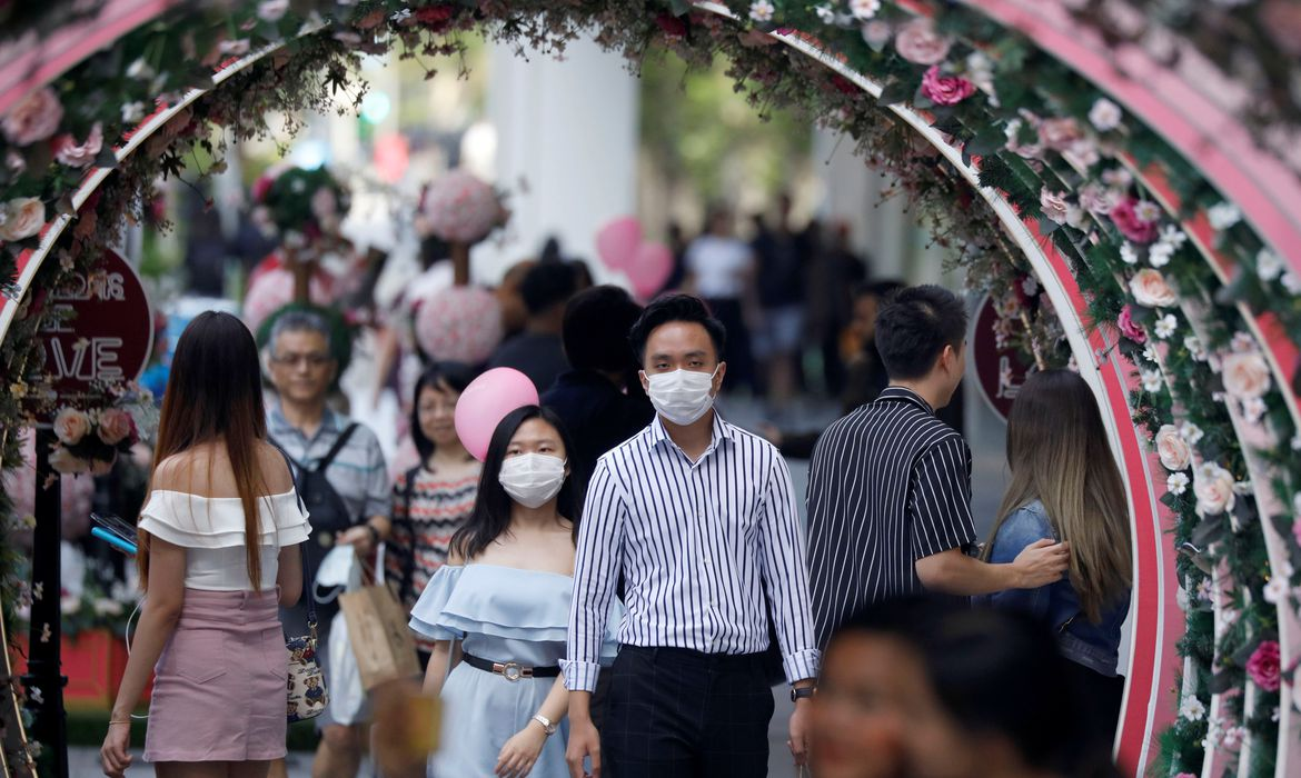 A couple celebrate Valentine's Day as they wear face masks in precaution of the coronavirus outbreak at Orchard Road in Singapore