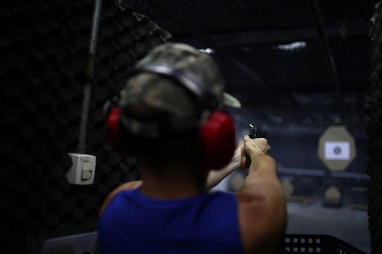 A member of the Colt 45 shooting club fires a gun in Rio de Janeiro, Brazil January 15, 2019. REUTERS/Pilar Olivares
