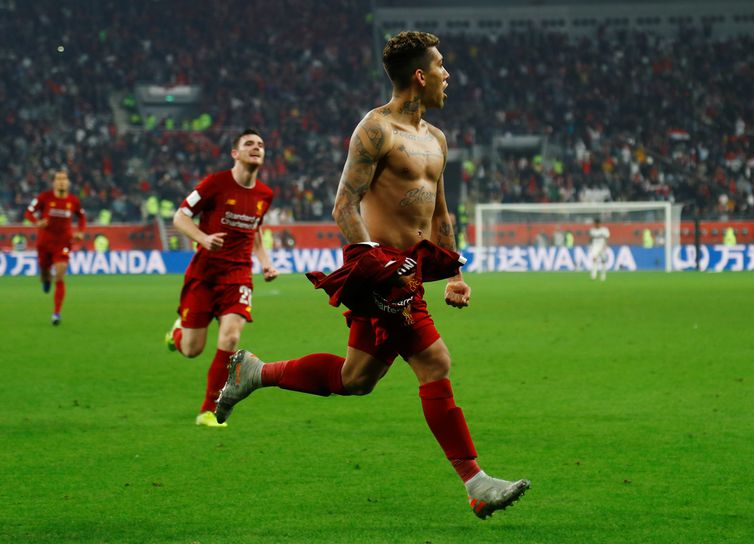 Soccer Football - Club World Cup - Final - Liverpool v Flamengo - Khalifa International Stadium, Doha, Qatar - December 21, 2019  Liverpool's Roberto Firmino celebrates scoring their first goal  REUTERS/Ibraheem Al Omari