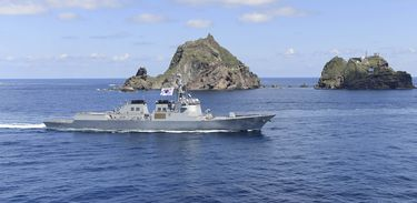 A South Korean Naval ship patrols around remote islands called Dokdo in Korean and Takeshima in Japanese during a military exercise, South Korea, August 25, 2019.   South Korean Navy/Yonhap via REUTERS   ATTENTION EDITORS - THIS IMAGE HAS BEEN