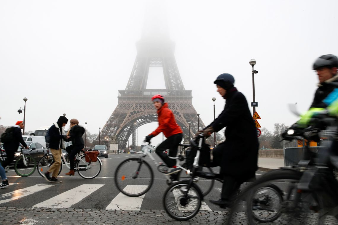 People ride bicycles near the Eiffel Tower during a strike by all unions of the Paris transport network (RATP) as part of a day of national strike and protests against French government's pensions reform plans, France, December 5, 2019.  REUTERS