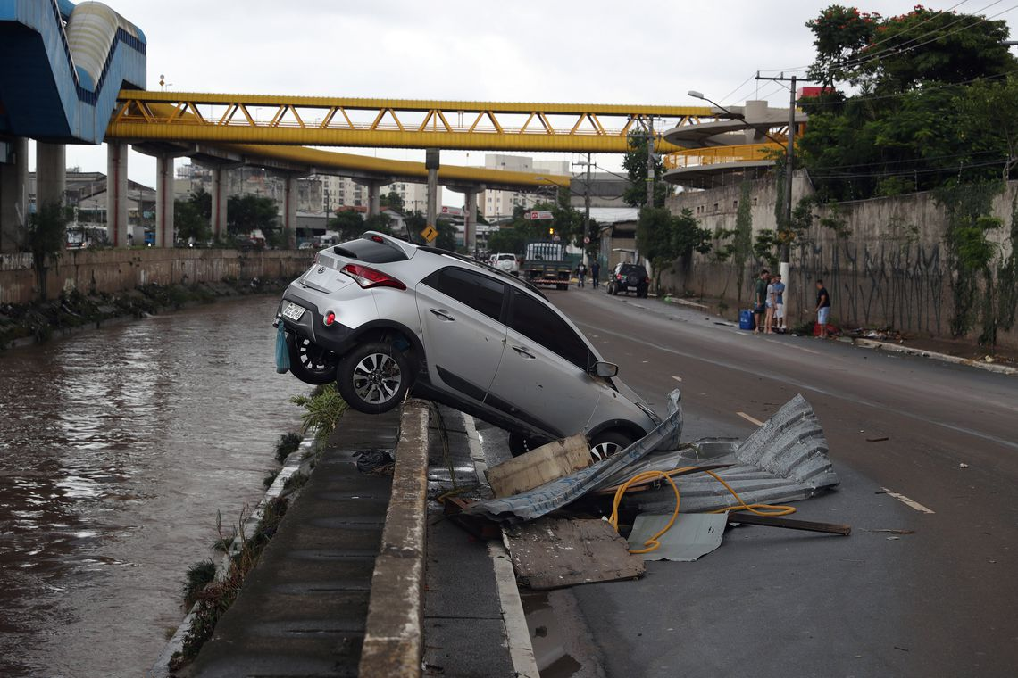 A car pushed by the floods to a channel is seen after heavy rains in Vila Prudente neighbourhood in Sao Paulo, Brazil March 11, 2019. REUTERS/Amanda Perobelli