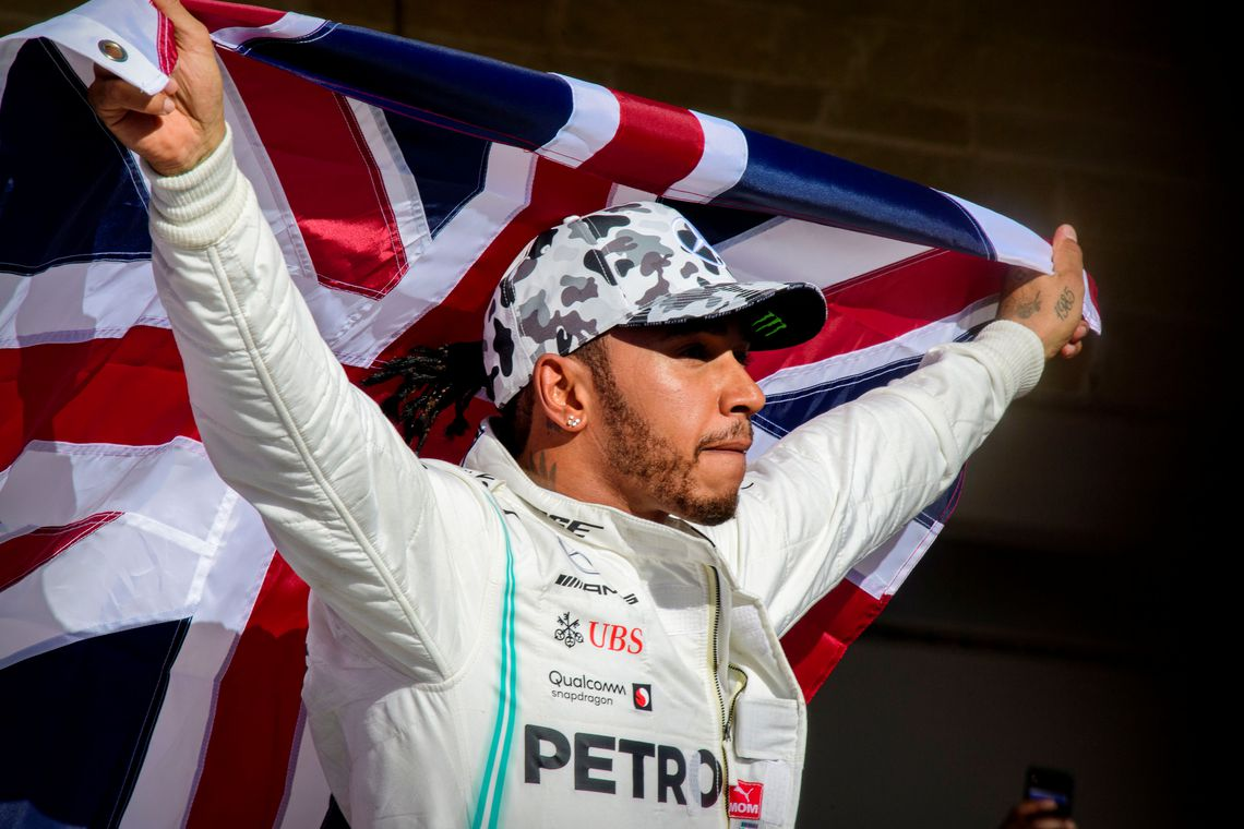 Nov 3, 2019; Austin, TX, USA; Mercedes AMG Petronas Motorsport driver Lewis Hamilton (44) of Great Britain holds up the Union Jack as he celebrates winning his sixth world championship after he finishes in second place in the United States Grand