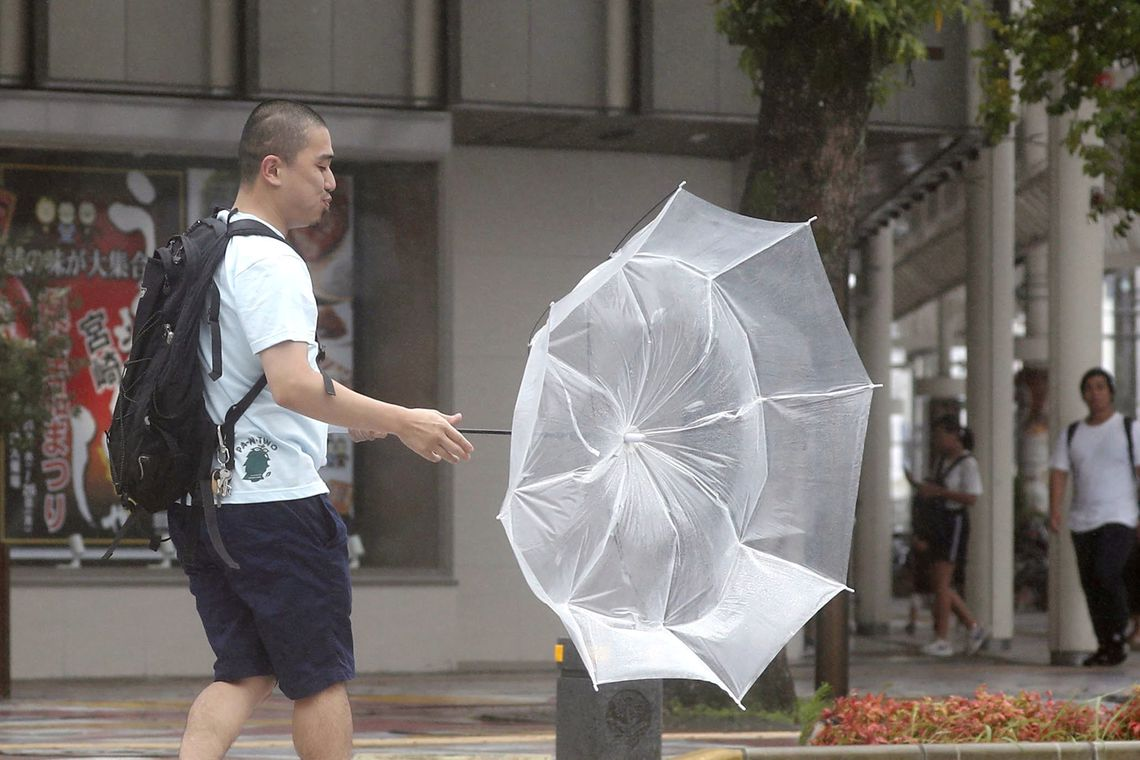 A man makes his way amid strong wind by typhoon Krosa in Miyazaki in this photo taken by Kyodo August 14, 2019. Mandatory credit Kyodo/via REUTERS Mandatory credit Kyodo/via REUTERS ATTENTION EDITORS - THIS IMAGE WAS PROVIDED BY A THIRD PARTY.