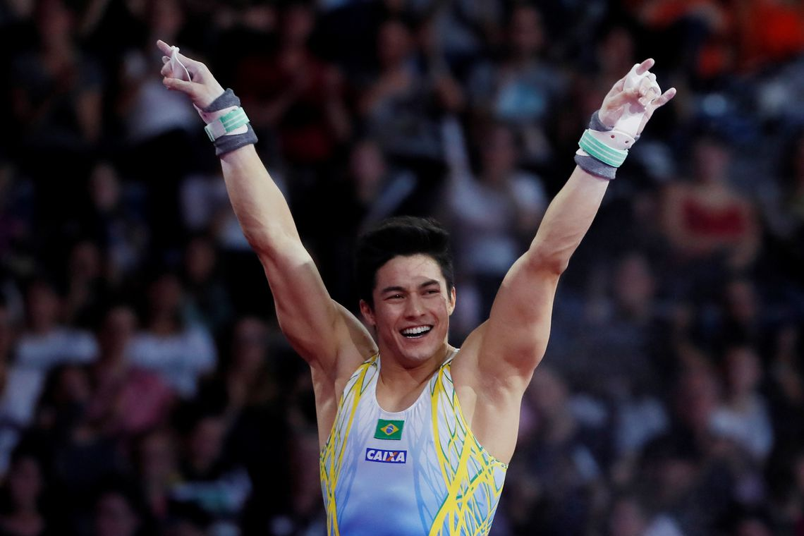 Artistic Gymnastics - 2019 World Artistic Gymnastics Championships - Men's Horizontal Bar Final - Hanns-Martin-Schleyer-Halle, Stuttgart, Germany - October 13, 2019 Brazil's Arthur Mariano reacts REUTERS/Wolfgang Rattay