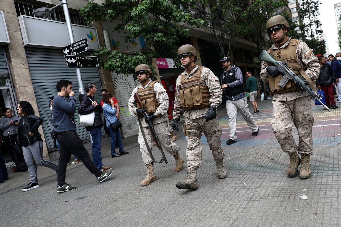 Soldiers patrol the street after a protest against the increase in subway ticket prices in Santiago, Chile, October 19, 2019 REUTERS/Edgard Garrido