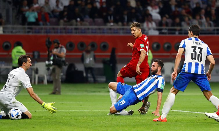 Soccer Football - Club World Cup - Semi Final - Monterrey v Liverpool - Khalifa International Stadium, Doha, Qatar - December 18, 2019  Liverpool's Roberto Firmino scores their second goal            REUTERS/Corinna Kern
