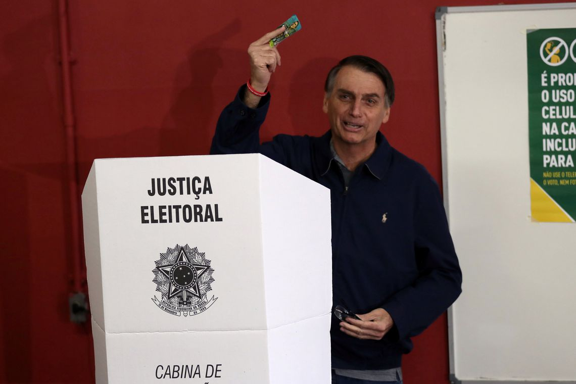 Jair Bolsonaro, far-right lawmaker and presidential candidate of the Social Liberal Party (PSL), casts his vote in Rio de Janeiro, Brazil October 7, 2018. REUTERS/Ricardo Moraes