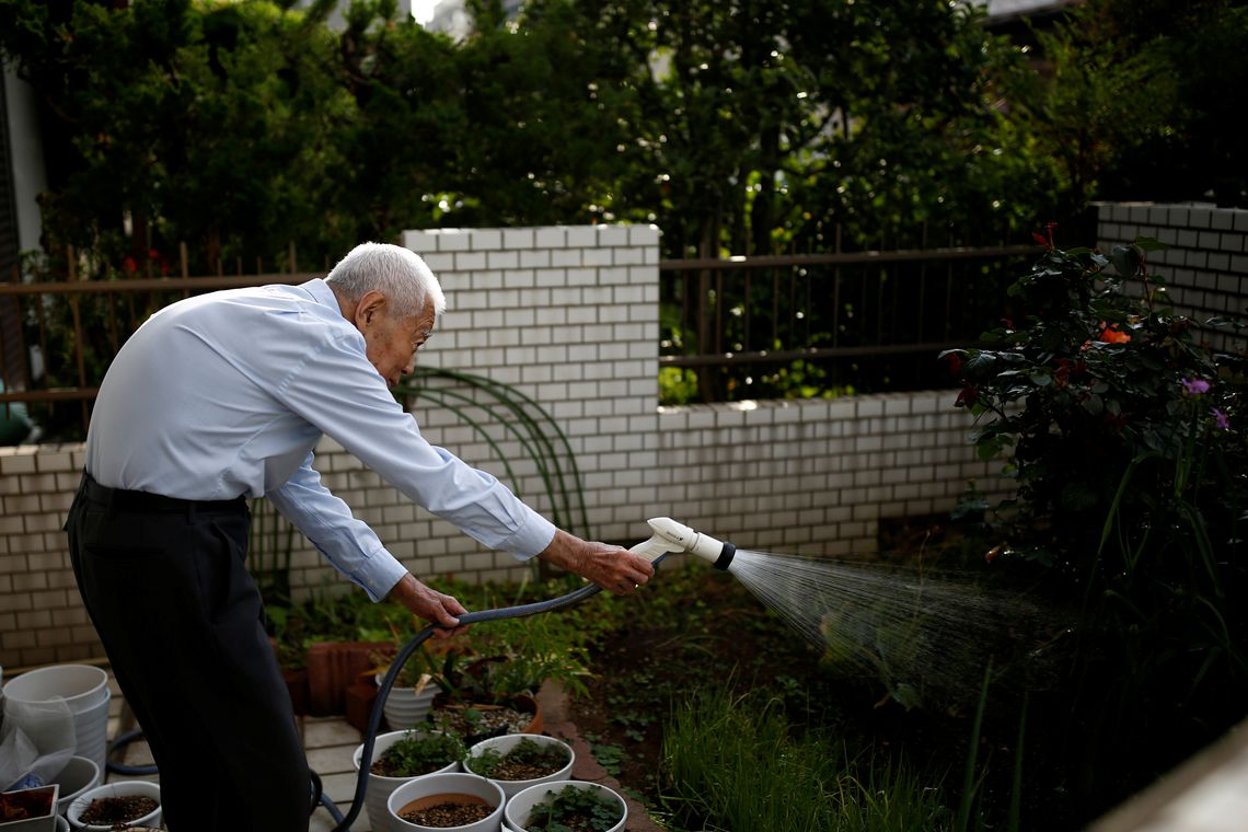 Ryuichi Nagayama, 86, Fuwaku Rugby Club's oldest active player, waters his garden at his house in Tokyo, Japan, May 18, 2019. As a doctor, Nagayama is well aware of the risks involved in playing a high impact sport at his age and the club's