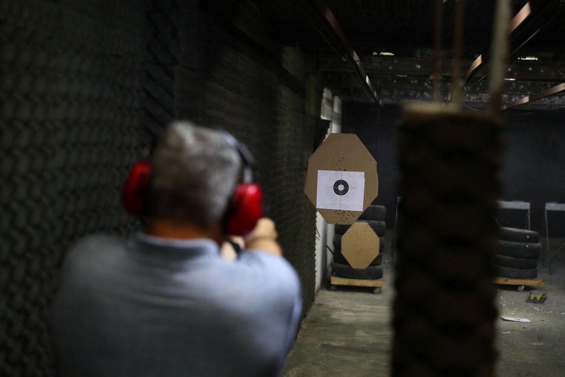 A member of the Colt 45 shooting club fires a gun in Rio de Janeiro, Brazil January 15, 2019. REUTERS/Pilar Olivares