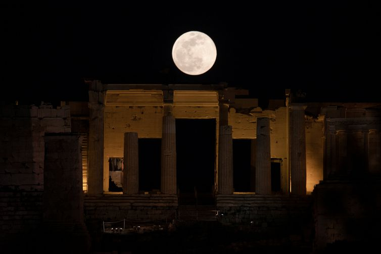 A super snow moon is seen over the Propylaea at the archaeological site of the Acropolis in Athens, Greece February 19, 2019.