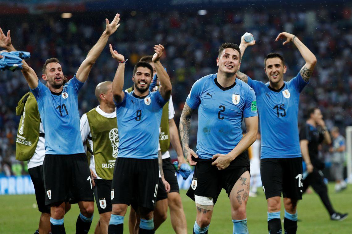 Soccer Football - World Cup - Round of 16 - Uruguay vs Portugal - Fisht Stadium, Sochi, Russia - June 30, 2018   Uruguay's Luis Suarez, Jose Gimenez and team mates celebrate after the match                  REUTERS/Murad Sezer