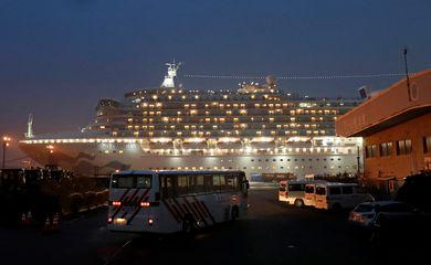A bus arrives at the cruise ship Diamond Princess at Daikoku Pier Cruise Terminal in Yokohama