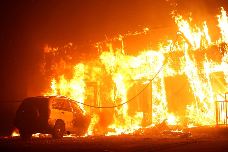 A structure is seen engulfed in flames during the Camp Fire in Paradise, California, U.S. November 8, 2018. REUTERS/Stephen Lam