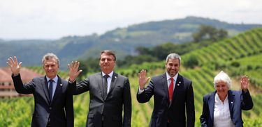 Argentina's President Mauricio Macri, Brazil's President Jair Bolsonaro, Paraguay's President Mario Abdo Benitez and Uruguay's Vice President Lucia Topolansky wave as they pose for a family picture during the Mercosur trade bloc summit, in