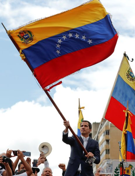 Juan Guaido, President of Venezuela's National Assembly, waves Venezuelan flag during a rally against Venezuelan President Nicolas Maduro's government and to commemorate the 61st anniversary of the end of the dictatorship of Marcos Perez Jimenez