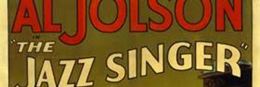 """Poster de divulgação do filme """"O Cantor de Jazz"""", pioneiro em utilizar um sistema sonoro eficaz"""