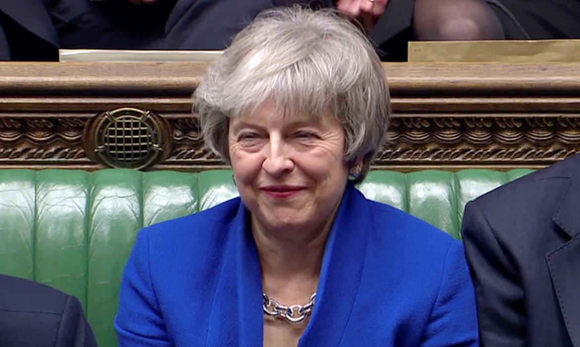 British Prime Minister Theresa May reacts as Jeremy Corbyn speaks, after she won a confidence vote, after Parliament rejected her Brexit deal, in London, Britain, January 16, 2019, in this screen grab taken from video. Reuters TV via REUTERS