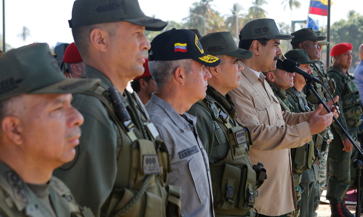 Venezuela's President Nicolas Maduro speaks next to military high command members during a military exercise in Puerto Cabello, Venezuela January 27, 2019. Miraflores Palace/Handout via REUTERS ATTENTION EDITORS - THIS PICTURE WAS PROVIDED BY A