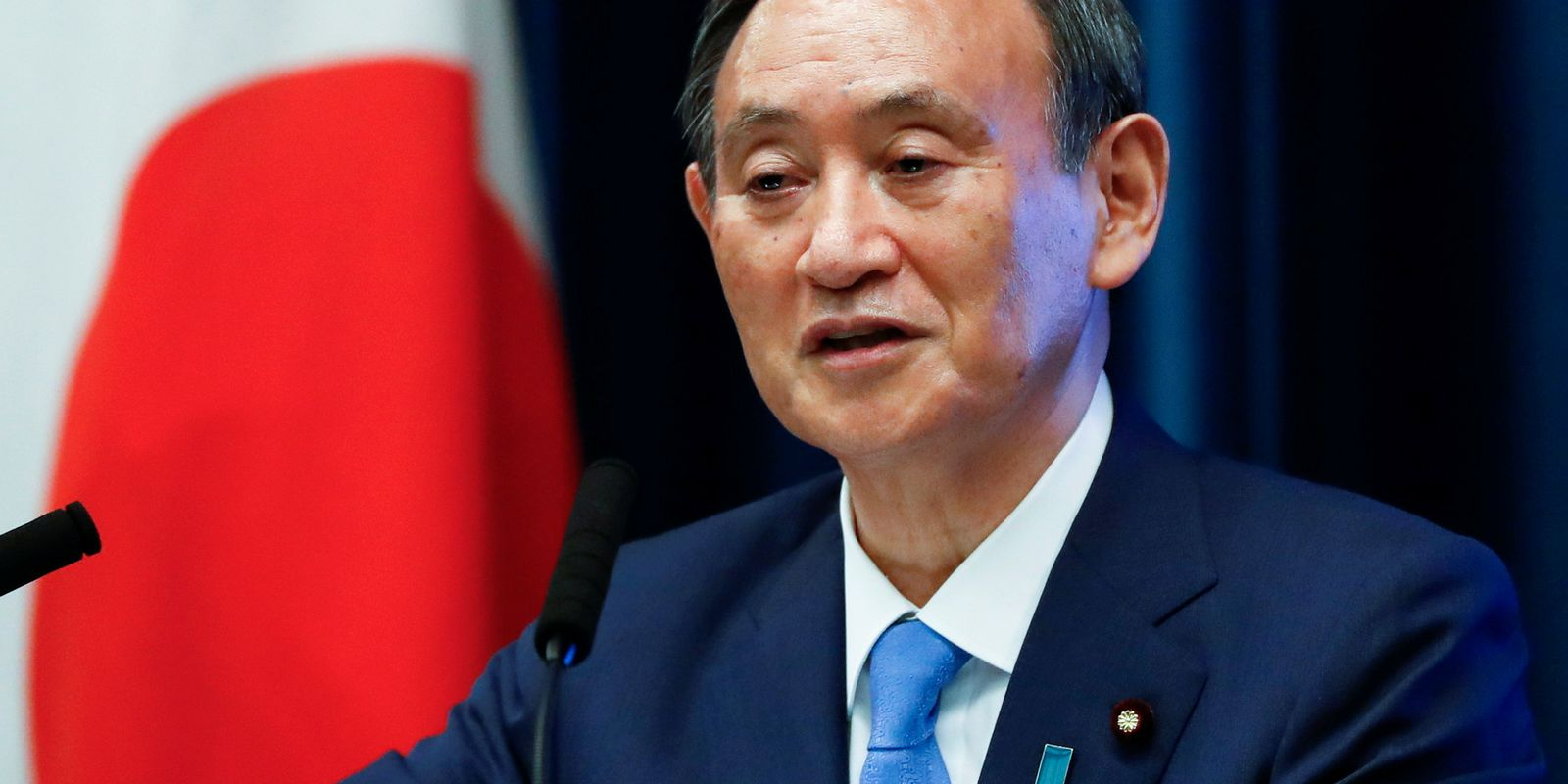 Japan's Prime Minister Yoshihide Suga attends a news conference on Japan's response to the coronavirus disease (COVID-19) outbreak, in Tokyo