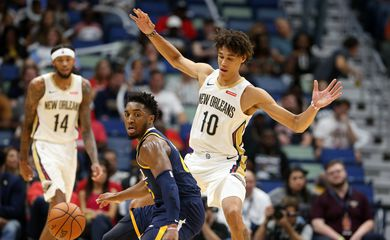 Oct 11, 2019; New Orleans, LA, USA; Utah Jazz guard Donovan Mitchell (45) dribbles against New Orleans Pelicans center Jaxson Hayes (10) in the second quarter at the Smoothie King Center. Mandatory Credit: Chuck Cook-USA TODAY Sports