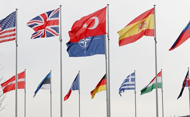 Flags of NATO member countries flutter at the Alliance headquarters in Brussels