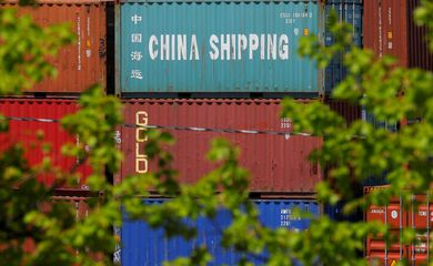 FILE PHOTO: Shipping containers, including one labelled