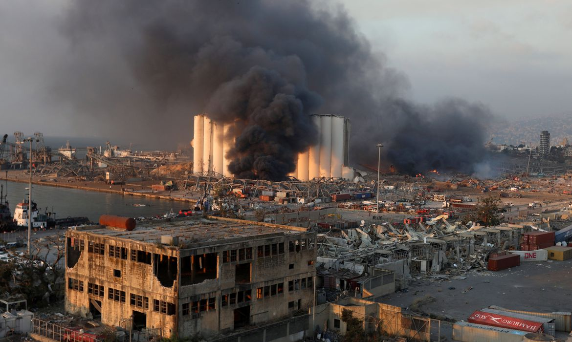 Smoke rises from the site of an explosion in Beirut's port area
