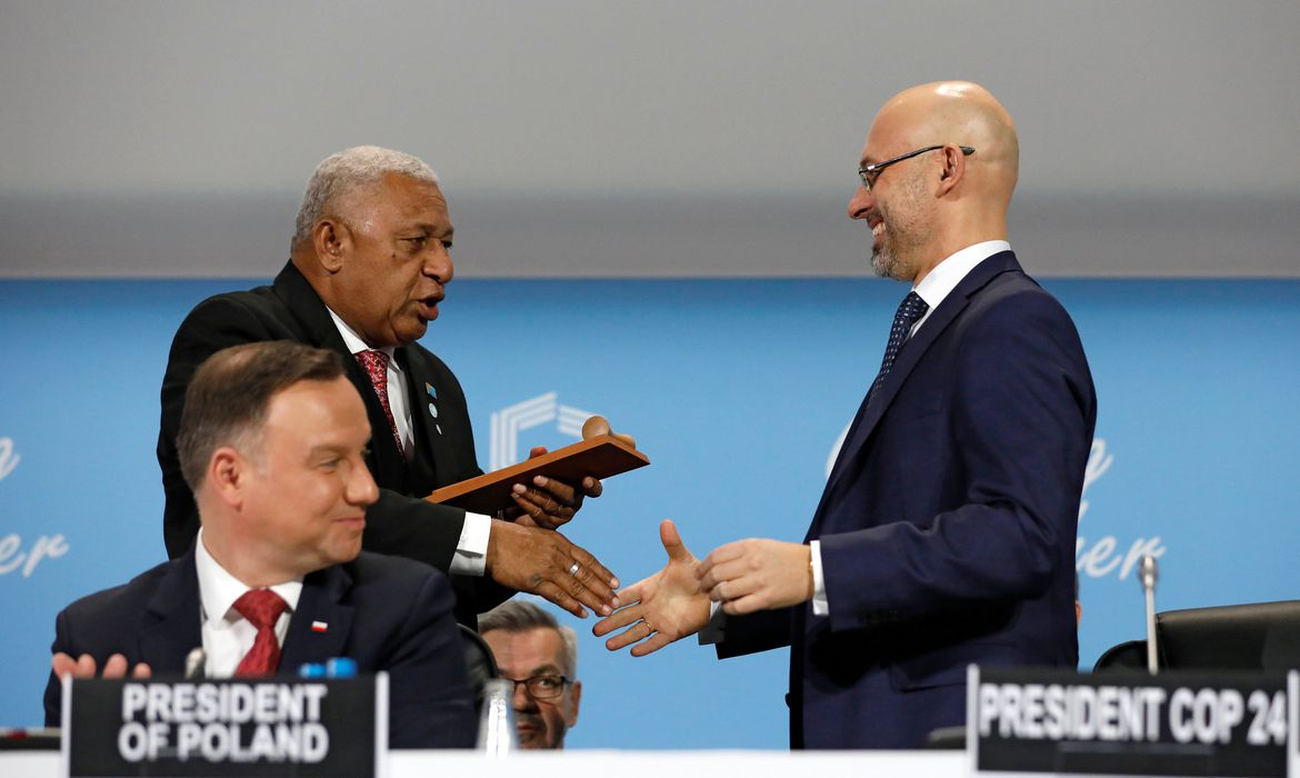 Prime Minister of Fiji and COP 23 President Frank Bainimarama talks with the President of COP 24 Michal Kurtyka as Polish President Andrzej Duda looks on during the opening of COP24 UN Climate Change Conference 2018 in Katowice, Poland December