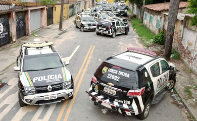 Military police vehicles are seen in front of their battalion during a police strike in Fortaleza