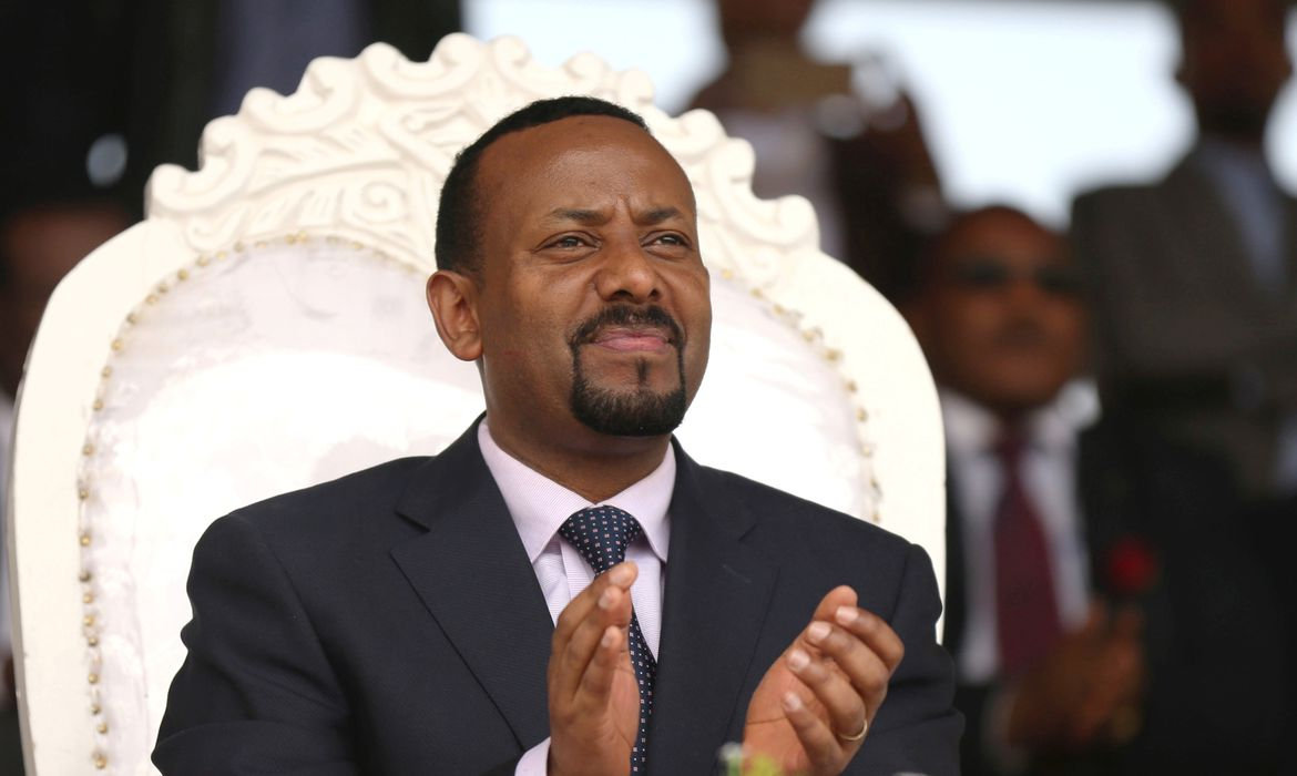 FILE PHOTO: Ethiopia's newly elected prime minister Abiy Ahmed attends a rally during his visit to Ambo in the Oromiya region, Ethiopia April 11, 2018. REUTERS/Tiksa Negeri/File Photo