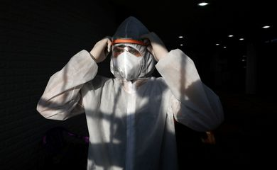 A Palestinian volunteer wears protective gear before sanitizes a mosque in Jerusalem to help fight coronavirus disease (COVID-19)