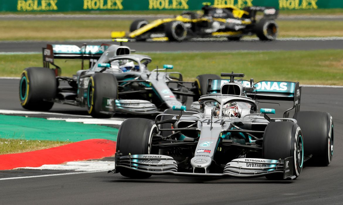 FILE PHOTO: Mercedes' drivers Lewis Hamilton and Valtteri Bottas in action at the 2019 British Grand Prix at Silverstone