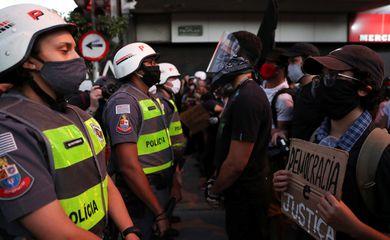 People attend a demonstration against Brazilian President Jair Bolsonaro, in Sao Paulo