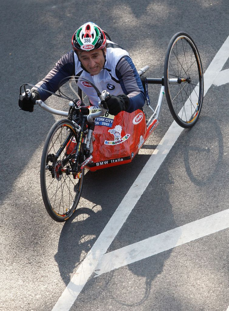 FILE PHOTO: Italian Race car driver Alex Zanardi crosses the finish line in the Handcycle Division during the 2007 ING New York City Marathon in New York