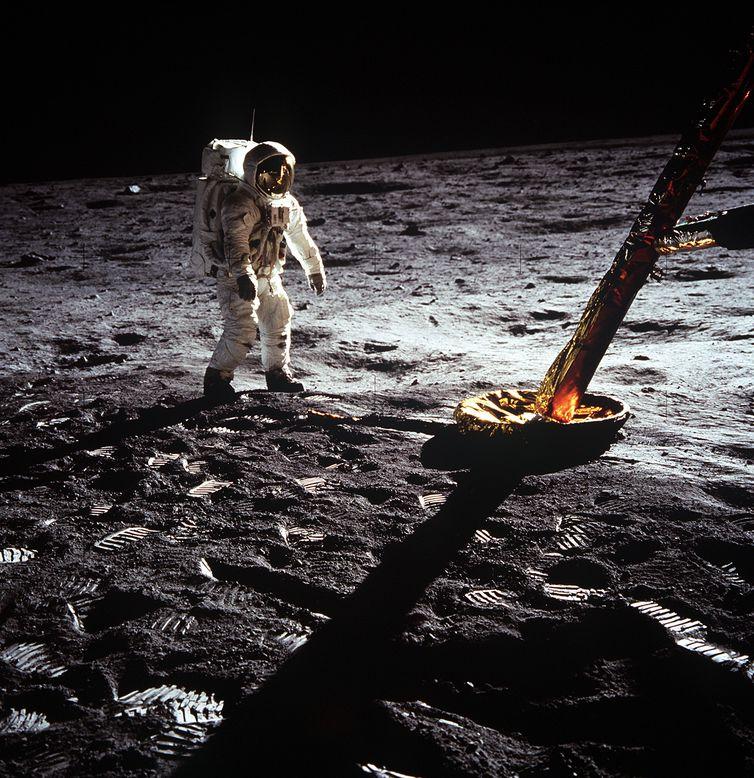 AS11-40-5902 (20 July 1969) --- Astronaut Edwin E. Aldrin Jr., lunar module pilot, walks on the surface of the moon near a leg of the Lunar Module during the Apollo 11 extravehicular activity (EVA). Astronaut Neil A. Armstrong, Apollo 11
