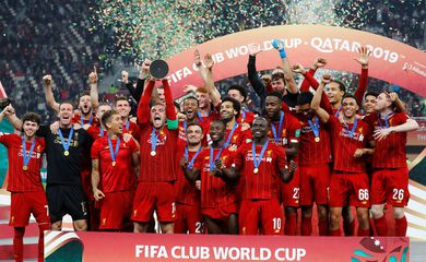Soccer Football - Club World Cup - Final - Liverpool v Flamengo - Khalifa International Stadium, Doha, Qatar - December 21, 2019  Liverpool's Jordan Henderson lifts the trophy as they celebrate after winning the Club World Cup  REUTERS/Kai