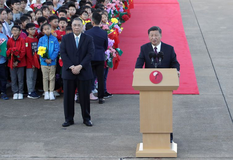 Chinese President Xi Jinping speaks next to outgoing Macau Chief Executive Fernando Chui, upon his arrival at Macau International Airport in Macau, China December 18, 2019, ahead of the 20th anniversary of the former Portuguese colony's return