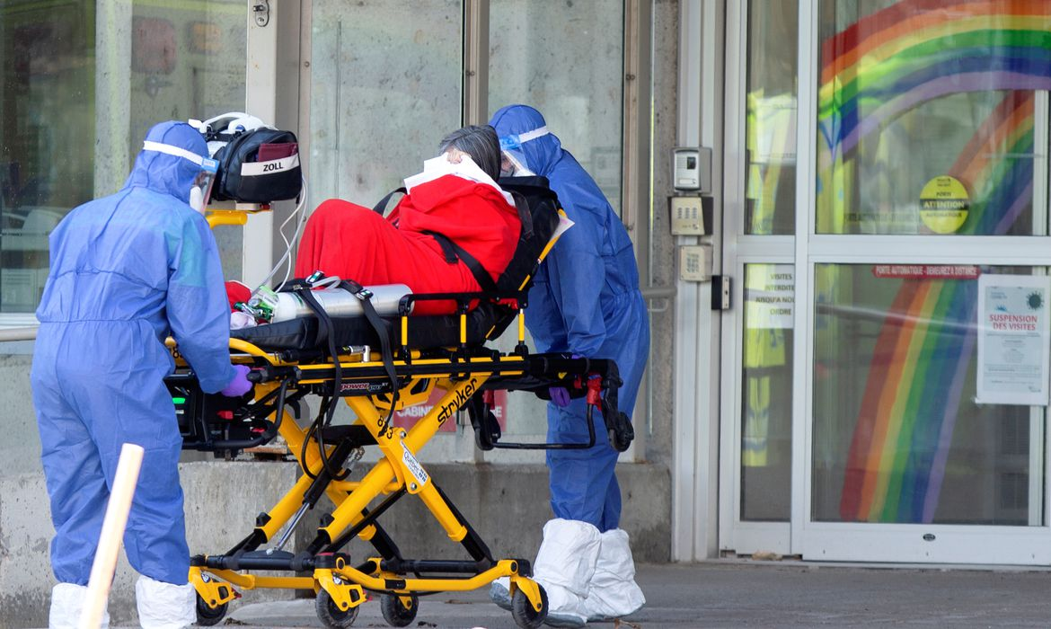 Ambulance attendants transport a resident from seniors' long-term care centre in Laval