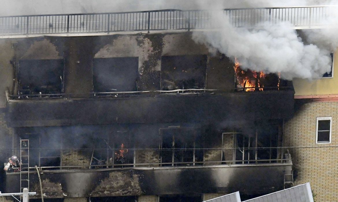 An aerial view shows smoke and flame rise from the three-story Kyoto Animation building which was torched in Kyoto, western Japan, in this photo taken by Kyodo July 18, 2019. Mandatory credit Kyodo/via REUTERS ATTENTION EDITORS - THIS IMAGE WAS