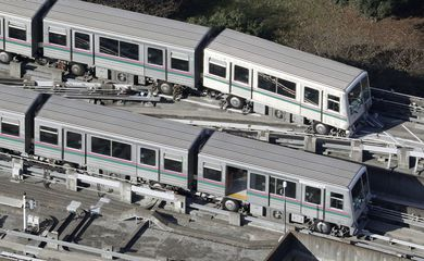 A Nippori-Toneri Liner train is derailed slightly after an earthquake jolted the Tokyo region the previous night in Tokyo