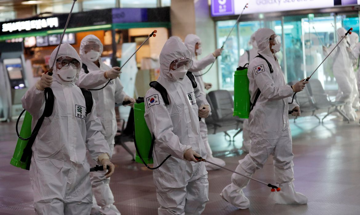 South Korean soldiers spray disinfectant at the international airport amid the rise in confirmed cases of coronavirus disease (COVID-19) in Daegu