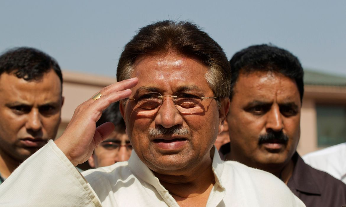 FILE PHOTO: Pakistan's former President and head of the All Pakistan Muslim League (APML) political party Pervez Musharraf salutes as he arrives to unveil his party manifesto for the forthcoming general election at his residence in Islamabad