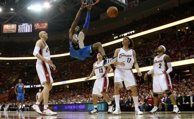 FILE PHOTO: Orlando Magic centre Dwight Howard knocks the 24-second clock off the backboard with a ferocious dunk during his side's 107-106 victory against Cleveland Cavaliers in Game 1 of their Eastern Conference Final playoff game