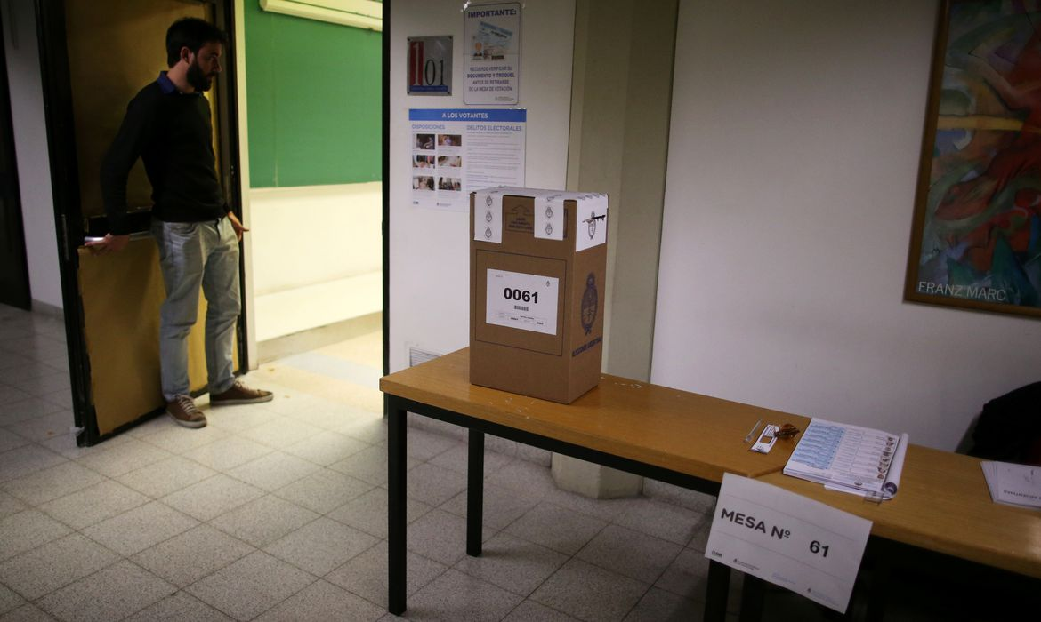 A ballot box stands on a table at a polling station during primary elections in Buenos Aires, Argentina, August 11, 2019. REUTERS/Agustin Marcarian