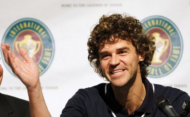 Tennis Hall of Fame inductee Kuerten of Brazil answers a question during a news conference at International Tennis Hall of Fame in Newport