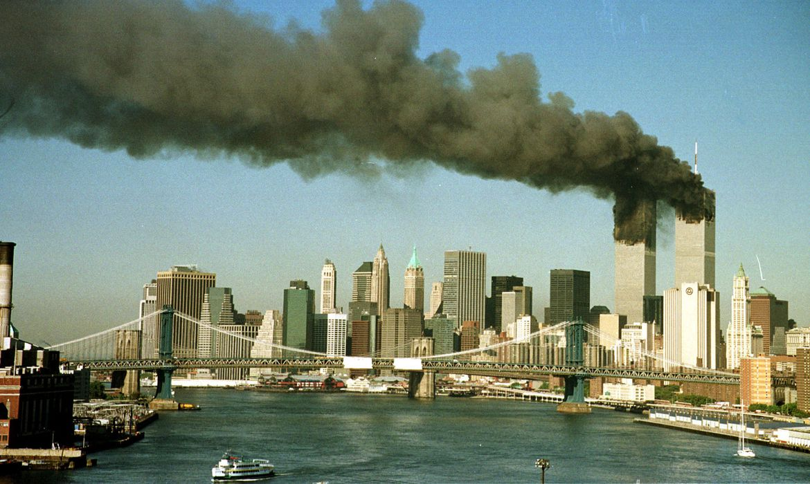 A September 11, 2001 file photo shows the towers of the World Trade Center pour smoke.