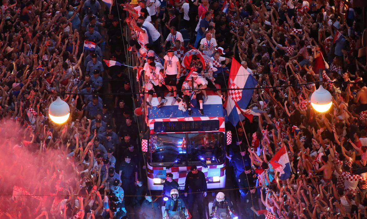Soccer Football - World Cup - The Croatia team return from the World Cup in Russia - Zagreb, Croatia - July 16, 2018   Croatia team bus and fans during the parade   REUTERS/Marko Djurica