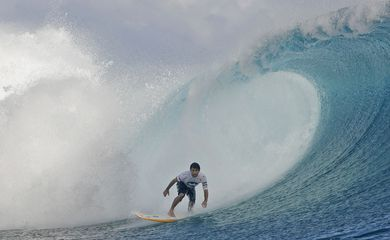 Brazilian surfer Santos competes in the Billabong Pro surfing tournament in Teahupoo